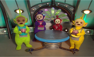 Teletubbies holding the Tubby Custards