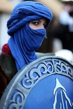 Tg character portrait irl female shield middle eastern blue