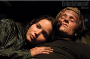 Katniss with Peeta in cave