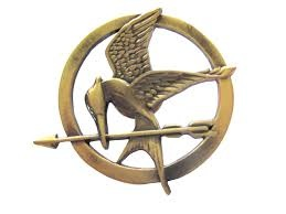 File:Mockingjay pin ( Katniss Everdeen's token) .jpg