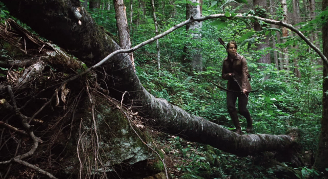 File:KAtniss hunting in the woods.png