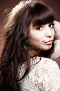 180px-14389712-a-pretty-girl-with-chocolate-hair-over-brown