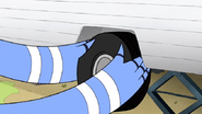 S4E27.076 Mordecai Putting in a New Trailer Tire