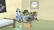 S4E12.111 Mordecai, Rigby, and Hi-Five Holding Down Muscle Man