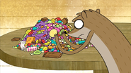 S3E04.249 Rigby Going Through His Candy