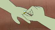 S6E05.169 Muscle Man Putting the Ring on Starla