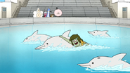 S6E05.059 Muscle Man Swimming with the Dolphins