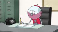 S6E13.031 Benson Working at His Desk