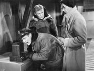 Hendry uses the intercom - The Thing (1951)