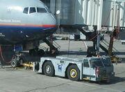Airplane pushing vehicle