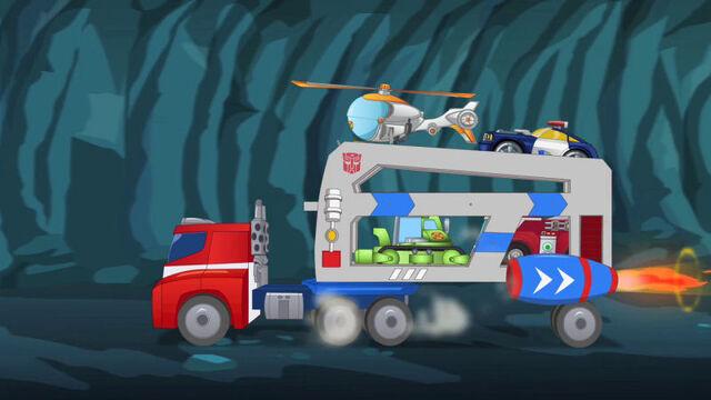 File:WhatLiesBelow Optimus rocket trailer.jpg