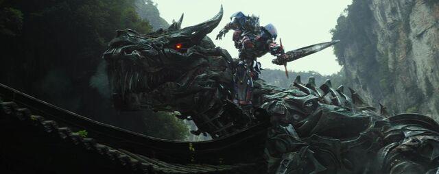 File:Optimus Riding Grimlock.jpg