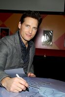 Peter Facinelli with poster