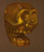 File:Amber Skull Bead.PNG