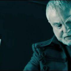 Alexander examines Viktor's corpse.
