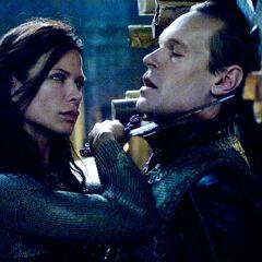 Tanis held at knife edge by Sonja.