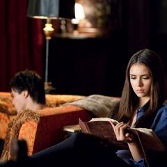 Katherine reading the journal.
