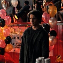 Jeremy serving drinks at the school dance.