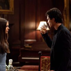 Elena giving Damon a drink