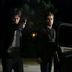 Stefan, and Damon shooting at Logan.