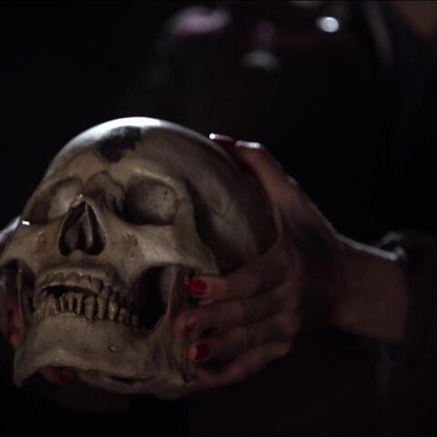 Sophie holding Celeste's skull