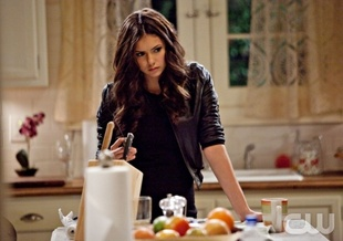 File:Elena conspiring in kitchen.jpg