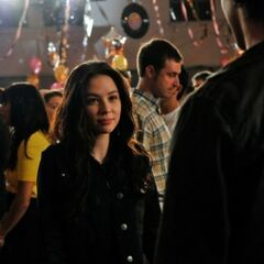 Anna talking to Jeremy at the school dance.