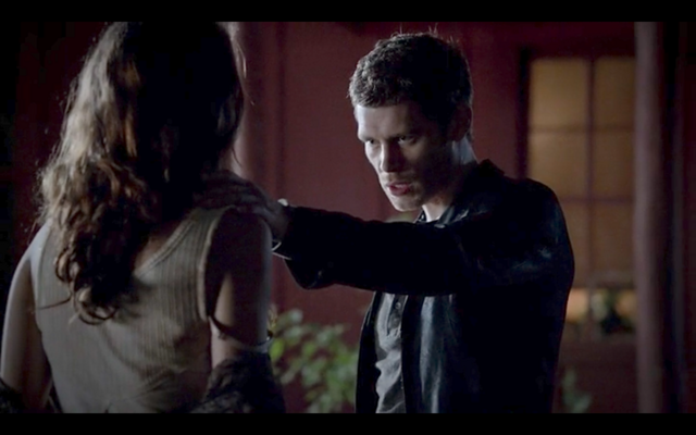 File:1x04-Klaus checks Hayley's wounds.png