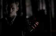 Klaus holding adrian's heart