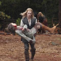 Henrik being carried by Klaus