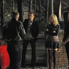 Stefan, Elena, Matt and Caroline outside the boarding house.