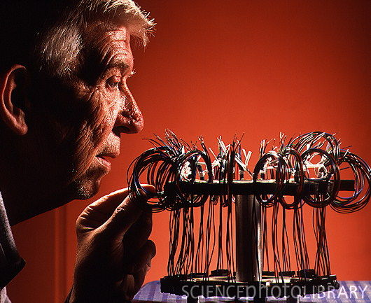 File:T3580095-Man examining wiring for electronic devices-SPL.jpg