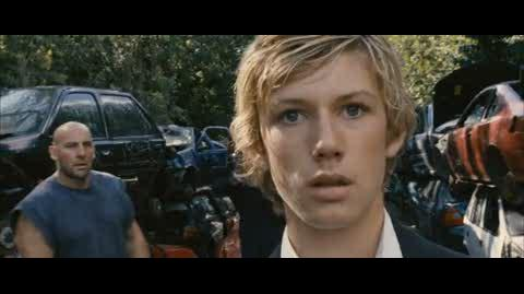 Alex Rider Operation Stormbreaker - alex fights men in scrap yard