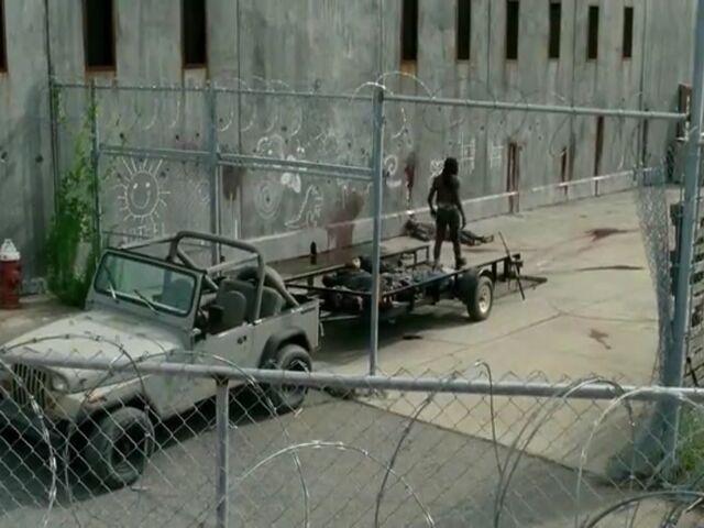 File:Michonne piled up killed walkers.jpg