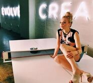 Emily new photoshoot sitting on top of a white pingpong table so cool