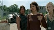 Maggie and Beth holding hands so sweet while Daryl secretly hands Maggie gun