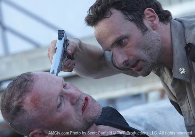 File:Merle Dixon threatened.jpg