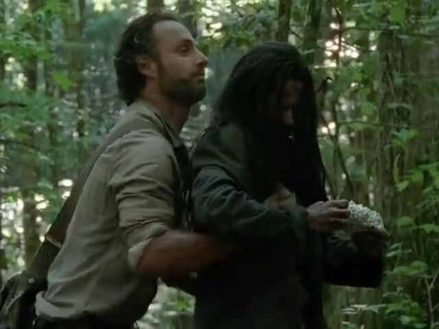 File:Rick inspects Clara for weapons.jpg
