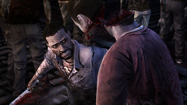 File:Twd-ep-5-screenshot-lee-cuts-zombie-head-in-two.jpg