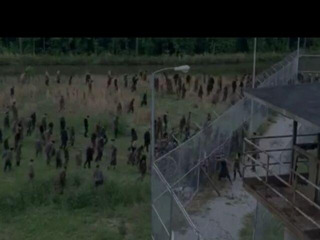 File:Prison vs Walkers.jpg