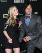 Emily and Norman about to hug on the red carpet