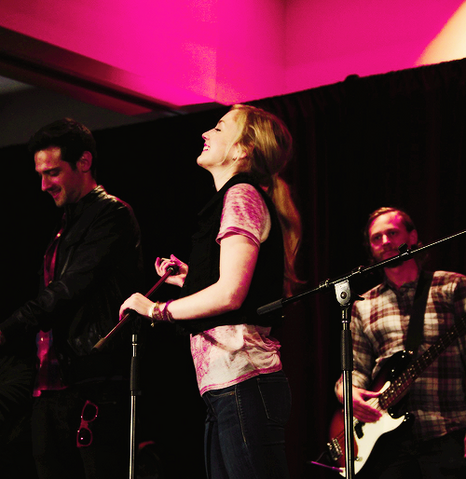 File:Emily taking a break and laughing in her concert.png