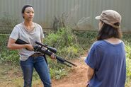 Sasha Williams Receives A Sniper Rifle from Rosita 7x14 Promotional Still