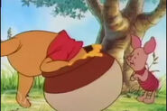 Winnie the Pooh is putting his head in a empty honey pot