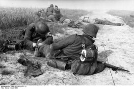 German Medic Treating a Wounded Soldier, France 1940