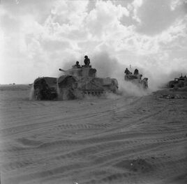 Churchill Mk III tanks of 'King Force' advance during the Second Battle of El Alamein, November 5, 1942