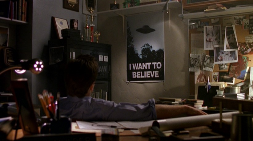 Mulder looks at his  X Files I Want To Believe Poster Mulder Office