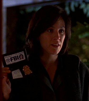 File:Monica Reyes showing badge.jpg
