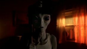 Grey alien with baseball paraphernalia
