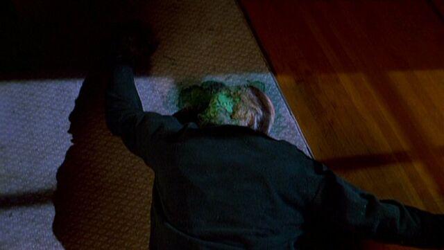 File:Faceless alien lies dead.jpg